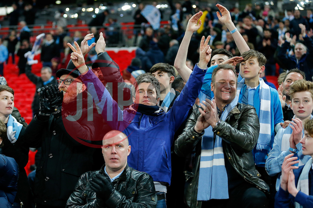 Musician and Manchester City fan Noel Gallagher celebrates in the stand after his side win on penalties to lift the 2015/16 Capital One Cup - Mandatory byline: Rogan Thomson/JMP - 28/02/2016 - FOOTBALL - Wembley Stadium - London, England - Liverpool v Manchester City - Capital One Cup Final.