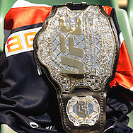 SYDNEY, AUSTRALIA, FEBRUARY 24, 2011: A UFC title belt is placed atop a custom Sydney Roosters jersey during a media event at Sydney Football Stadium in Sydney, Australia on February 24, 2011