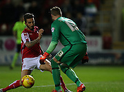 Rotherham United striker Matt Derbyshire (27) almost takes the ball off Brighton goalkeeper, David Stockdale (13) during the Sky Bet Championship match between Rotherham United and Brighton and Hove Albion at the New York Stadium, Rotherham, England on 12 January 2016.
