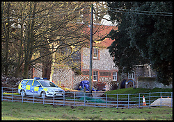 A police car parked at the entrance to Prince William & Kate's new Norfolk Home Anmer Hall, Norfolk, United Kingdom, The building is having building work done they have a new roof put on before they move in. Roofers renovating the Norfolk mansion are replacing old, weathered tiles with garish red ones not in keeping with the 1800s building. Sunday, 22nd December 2013. Picture by Andrew Parsons / i-Images