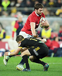"""Iain Henderson of the Lions fends off Otere Black of the Hurricanes in the International rugby match between the the Super Rugby Hurricanes and British and Irish Lions at Westpac Stadium, Wellington, New Zealand, Tuesday, June 27, 2017. Credit:SNPA / Ross Setford  **NO ARCHIVING"""""""