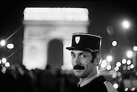 French police, gendarmes, near the Arc de Triomphe on the Champs Elysees, Paris, New Year's Eve, 1973-74 - Photograph by Owen Franken -