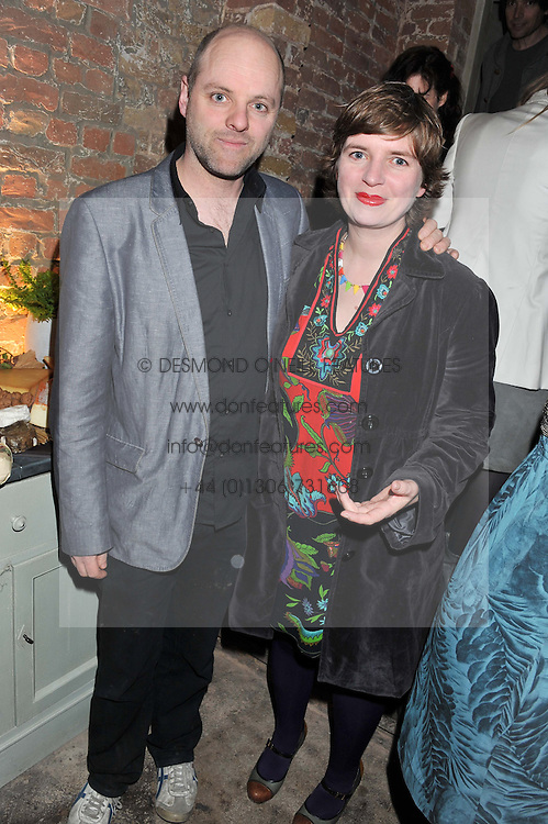 GAVIN TURK and DEBORAH CURTIS at an evening of cheesey culinary delights & champagne hosted by Alex James, Yasmin Mills and Elaine Foran held at Aubaine, 31 Dover Street, London on 20th March 2012.
