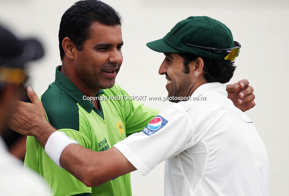Pakistan coach Waqar Younis and Umar Gul embrace as they celebrate victory over New Zealand on Day 3 of the 1st test match.  New Zealand Black Caps v Pakistan, Test Match Cricket. Seddon Park, Hamilton, New Zealand. Sunday 9 January 2011. Photo: Andrew Cornaga/photosport.co.nz