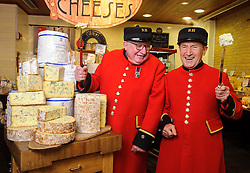 "© Licensed to London News Pictures. 17/12/2013 London, UK. Chelsea Pensioners Sandy Sanders and Jimmy Anderson celebrate the 100th anniversary of Colston Bassett Stilton at Whole Foods Market, Kensington, London. The world renowned cheese has been made in the same Nottinghamshire factory  since 1913 where only 4 head cheese makers have overseen the process. The cheese won  ""Best British Cheese' at this years World Cheese Awards.<br /> Photo credit : Simon Jacobs/LNP"