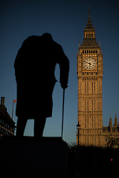 © Licensed to London News Pictures . 25/03/2017 . London , UK . The statue of Winston Churchill at sunset , silhouetted against a clear blue sky over Parliament and the Elizabeth Tower , after a warm spring day , ahead of the start of British Summer Time . Photo credit : Joel Goodman/LNP