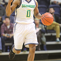 UNCW's Craig Ponder calls a play against Liberty Wednesday December 17, 2014 at Trask Coliseum on the campus of UNCW in Wilmington, N.C. (Jason A. Frizzelle)