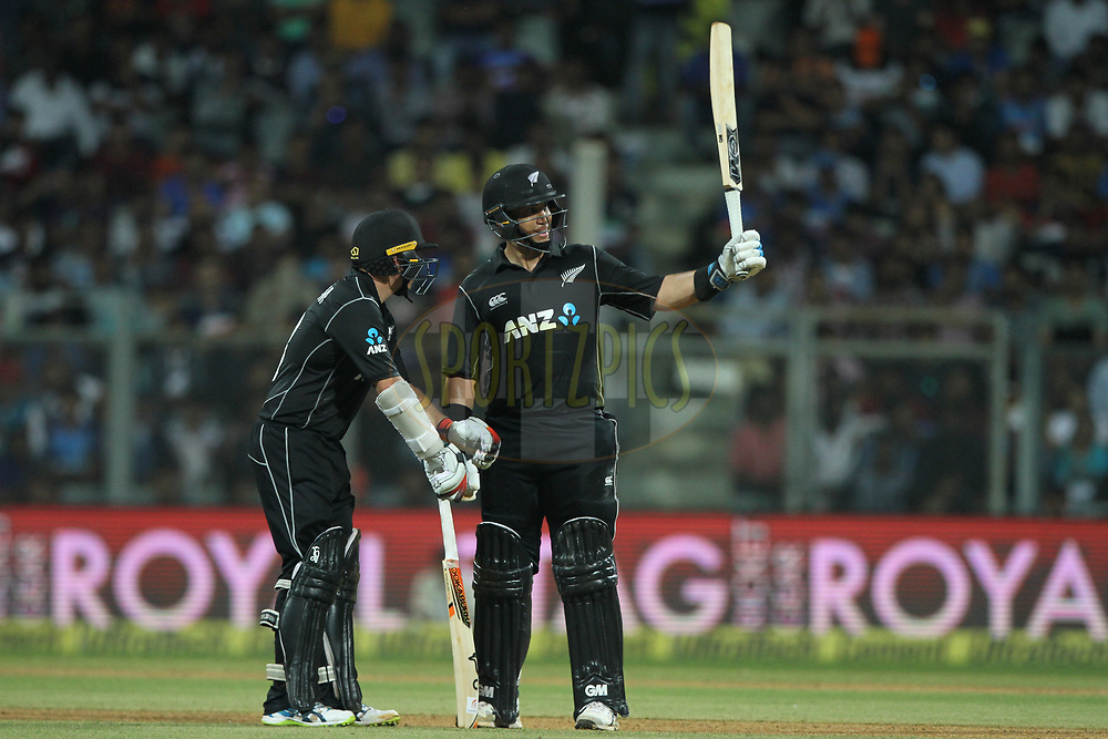 Ross Taylor of New Zealand raises his bat after scoring 50 runs during the 1st One Day International match between India and New Zealand held at the Wankhede Stadium in Mumbai on the 22nd October 2017<br /> <br /> Photo by Deepak Malik / BCCI / SPORTZPICS