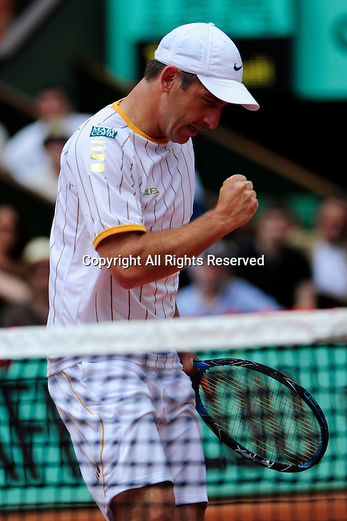 22.05.2011 French Open Tennis from Roland Garros Paris. Jan Hajek of the Czech Republic reacts happily as he wins a point in his match against Jo-Wilfried Tsonga of France on day one of the French Open tennis championships. The match was won by Tsonga 6-3, 6-2, 6-2.