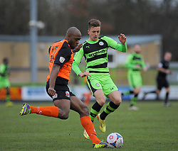 Forest Green Rovers's Elliott Frear tackles for the ball against Nuneaton Town's Ryan Smith - Photo mandatory by-line: Nizaam Jones/JMP - Mobile: 07966 386802 - 31/01/2015 - SPORT - Football - Nailsworth - The New Lawn - Forest Green Rovers v Nuneaton Town - Vanarama-Conference