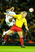 Photo: Ed Godden.<br /> Watford v Inter Milan. Pre Season Friendly. 08/08/2006.<br /> Jay DeMerit (R) clears the ball for Watford.