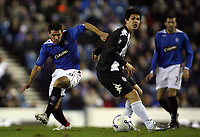 Photo: Paul Thomas.<br /> Glasgow Rangers v Partizan Belgrade. UEFA Cup. 14/12/2006.<br /> <br /> Ranger Nacho Novo (L) tries to go around Milan Smiljanic.