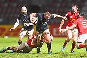 Hong Kong player Dan Barlow toys to break a tackle in the first half during the Rugby World Cup qualifier between Hong Kong and Canada at Stade Delort, Marseilles, France on 23 November 2018. Picture by Ian  Muir.