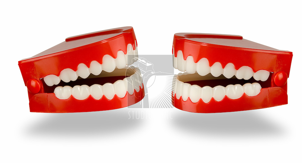 A pair of toy chattering teeth isolated on a white background with a clipping path