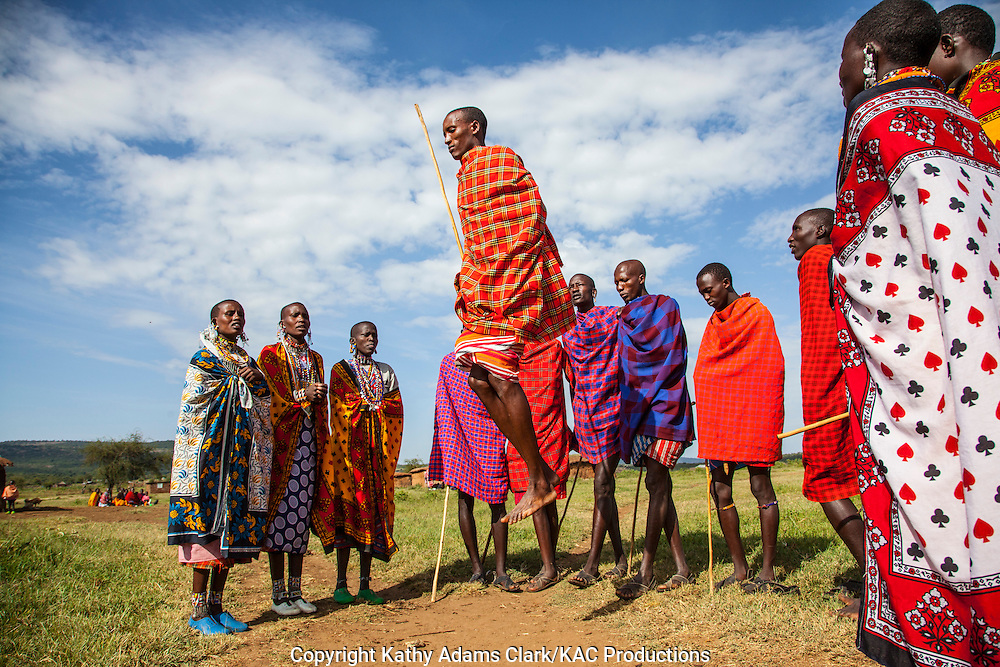 Maasai young people doing a jumping dance at a village outside, Serengeti National Park, Tanzania, Africa.