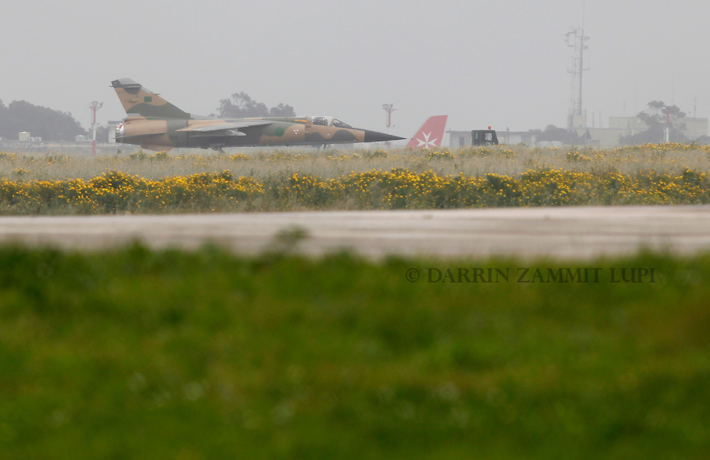 A Libyan Air Force Mirage F1 fighter jet is towed to a more secure part of Malta International Airport outside Valletta March 4, 2011.  The political asylum application of the two Libyan Air Force pilots who defected to Malta on February 21 is being considered and should be decided upon within weeks or months, according to a government spokesperson..REUTERS/Darrin Zammit Lupi (MALTA)