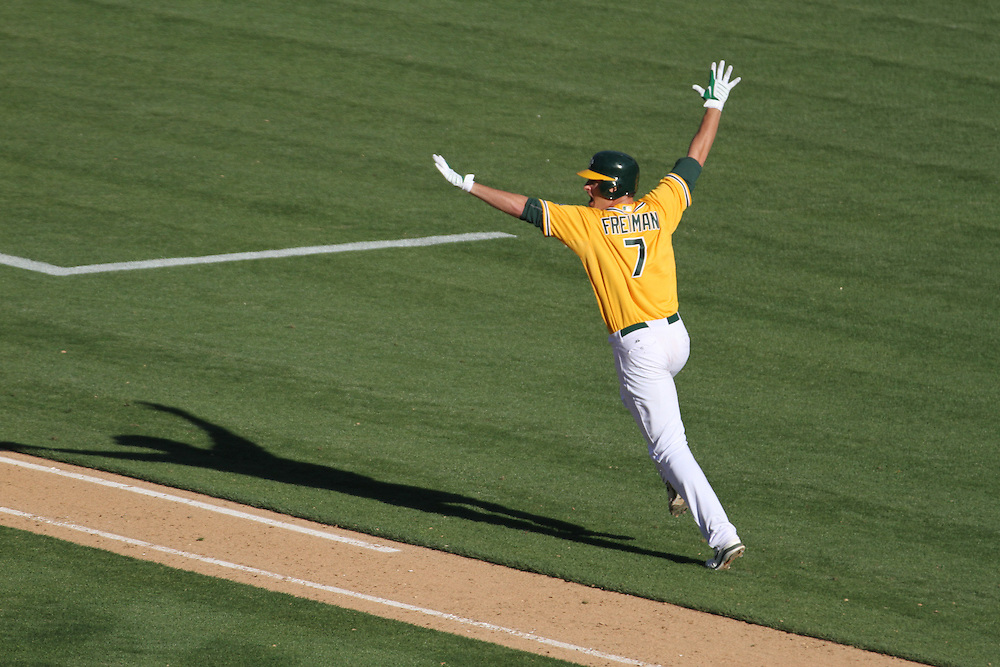 OAKLAND,CA JUN 13th: Nate Freiman of the Oakland Athletics celebrates a walkoff single in the 18th inning to give the A's a 3-2 win and a series sweep of the New York Yankees.