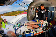 Adult Retrieval Victoria uses the Air Ambulence to bring critical patients from regeonal areas back to major hospitals in Melbourne. Patient Peter Norton was suffering from pneumonia which was complicated when doctors at Stawell hospital were unable to intubate his due to swelling. Dr Jack Spencer and Mica Flight Paramedic Neil Burden and Pilot Kym Anquetil were sent to bring him back to Dandenong Hospital for treatment, LOADING PATIENT AT STAWELL AIRSTRIP  Pic By Craig Sillitoe  25/09/2008 SPECIALX 000  Pic By Craig Sillitoe CSZ / The Sunday Age melbourne photographers, commercial photographers, industrial photographers, corporate photographer, architectural photographers, This photograph can be used for non commercial uses with attribution. Credit: Craig Sillitoe Photography / http://www.csillitoe.com<br />