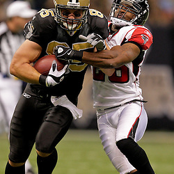 2009 November 02:  New Orleans Saints tight end David Thomas (85) is tackled by Atlanta Falcons safety Thomas DeCoud (28) during the second quarter at the Louisiana Superdome in New Orleans, Louisiana.