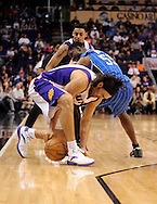 Dec. 09, 2012; Phoenix, AZ, USA; Phoenix Suns forward Luis Scola (14) and the Orlando Magic guard E'Twaun Moore (55) battle for the ball in the first half at US Airways Center. Mandatory Credit: Jennifer Stewart-USA TODAY Sports
