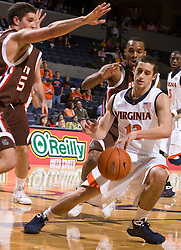 Virginia guard Sammy Zeglinski (13) is surrounded by Brown forward Chris Skrelja (22) and guard Adrian Williams (11).  The Virginia Cavaliers defeated the Brown University Bears 74-50 in NCAA Basketball at the John Paul Jones Arena on the Grounds of the University of Virginia in Charlottesville, VA on January 6, 2009.