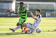 Morecambe's Luke Conlan(14) takes down Forest Green Rovers Reece Brown(10) is shown a yellow card, booked during the EFL Sky Bet League 2 match between Forest Green Rovers and Morecambe at the New Lawn, Forest Green, United Kingdom on 28 October 2017. Photo by Shane Healey.