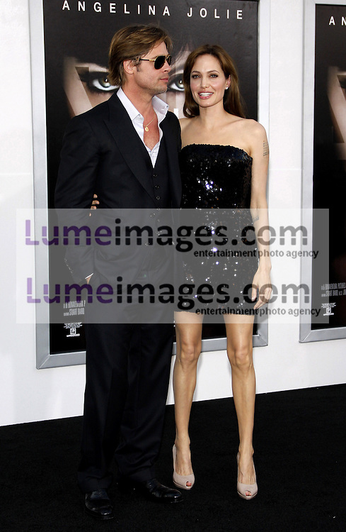 "Angelina Jolie and Brad Pitt at the Los Angeles premiere of 'Salt"" held at the Grauman's Chinese Theatre in Hollywood on July 19, 2010. Credit: Lumeimages.com"