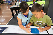 ROGERS, AR - OCTOBER 12:  Gabriel and Liberty Norton look at tablets in the Entertainment Department at Walmart Store #4208 on October 12, 2015 in Rogers, Arkansas.  <br /> CREDIT Wesley Hitt for Wall Street Journal<br /> WALSQUEEZE
