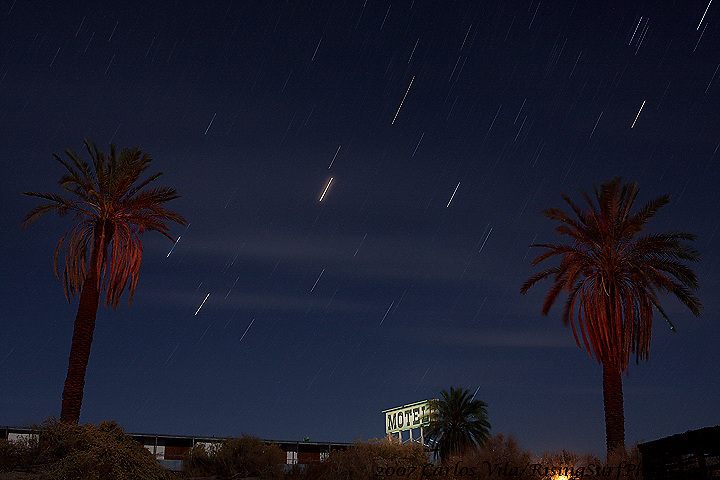 Abandoned hotel at the Salton Sea in California, 8 minute exposure, red gels and flash to light up the palm trees