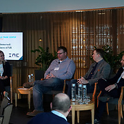 World Trade Center, Seattle Immersed: The Business of XR panel discussion with Jessie Irwin (IME Law), D'Arcy Salzmann (Microsoft HoloLens), Adam Sheppard (8ninths), and Mat Chacon (Doghead Simulations). Photo by Alabastro Photography.