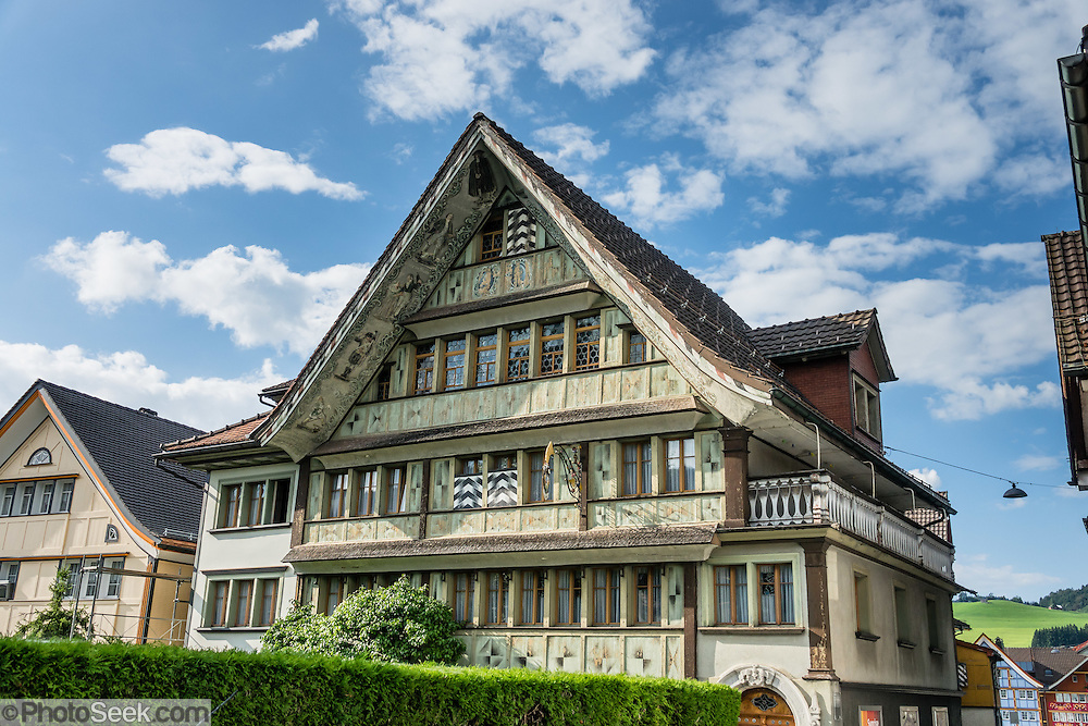 Konkordia House, on Engelgasse in Appenzell village, is a patrician house dating from the 1600s with a steep gabled roof. Decorated panels cover the southern facade and the paintings under the eaves represent the eight ages of man, created by August Schmid (1930). Appenzell Innerrhoden is Switzerland's most traditional and smallest-population canton (second smallest by area).