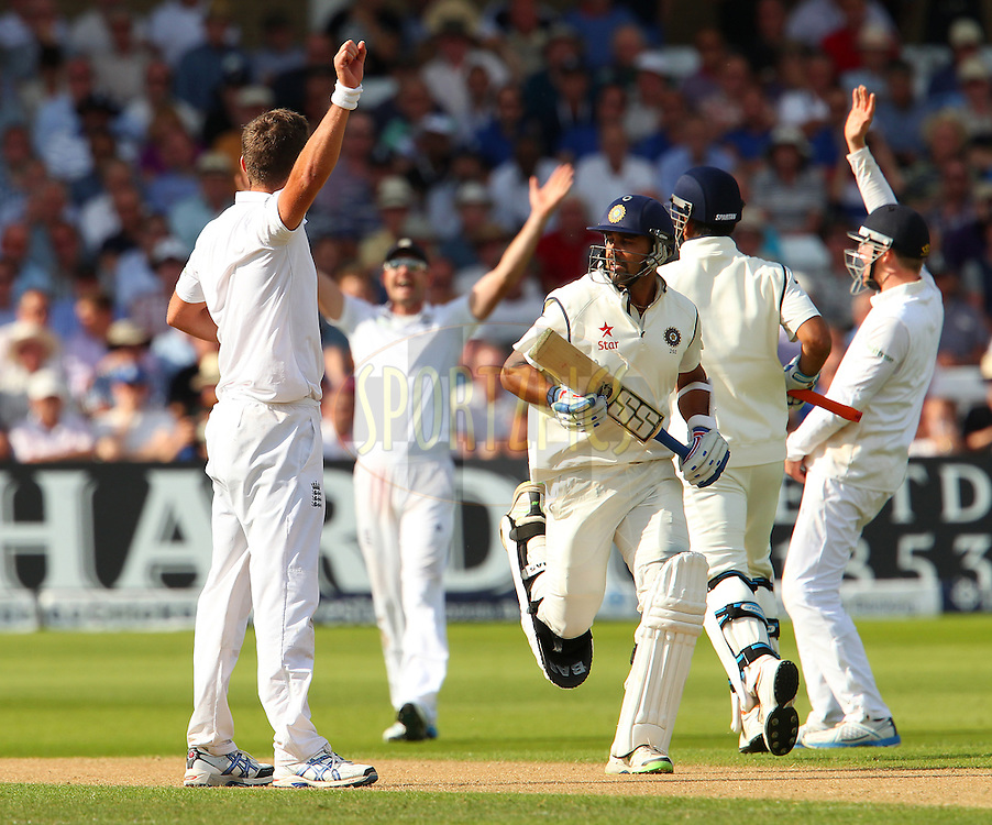 Murali Vijay of India runs through England cricket players appealing for his wicket during day one of the first Investec test match between England and India held at Trent Bridge cricket ground in Nottingham, England on the 9th July 2014<br /> <br /> Photo by Ron Gaunt / SPORTZPICS/ BCCI