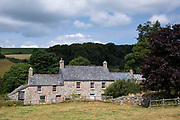 Farmhouse and farm on Dartmoor in Devon in Southern England, UK