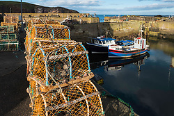 View of fishing harbour at St Abbs in Scotland, United Kingdom.