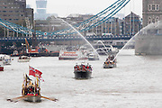 UNITED KINGDOM, London: 09 September 2015 The Queens row barge Gloriana leads a flotilla of boats under Tower Bridge this afternoon to mark the day the Queen becomes Britain's longest reigning monarch. Credit: Story Picture Agency