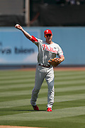 LOS ANGELES, CA - AUGUST 10:  Chase Utley #26 of the Philadelphia Phillies plays catch before the game against the Los Angeles Dodgers on August 10, 2011 at Dodger Stadium in Los Angeles, California. The Phillies won the game 9-8. (Photo by Paul Spinelli/MLB Photos via Getty Images) *** Local Caption *** Chase Utley