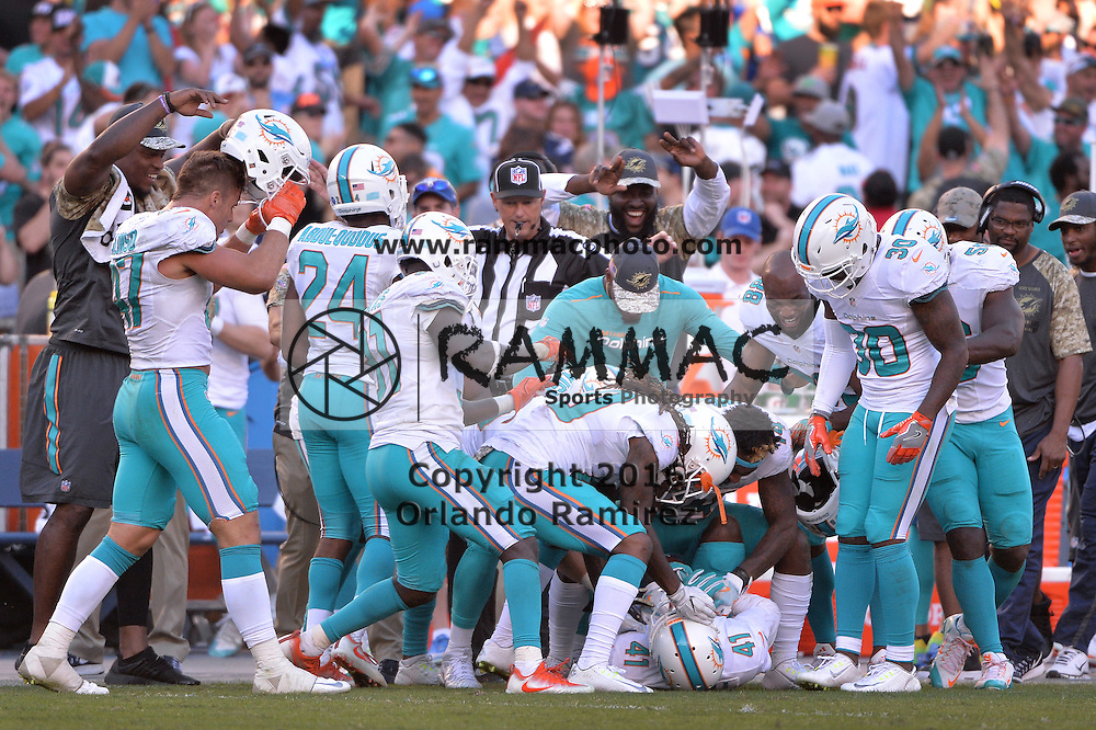 Nov 13, 2016; San Diego, CA, USA; Miami Dolphins cornerback Byron Maxwell (41) is congratulated by teammates after intercepting San Diego Chargers quarterback Philip Rivers (not pictured) during the second half at Qualcomm Stadium. Miami won 31-24. Mandatory Credit: Orlando Ramirez-USA TODAY Sports