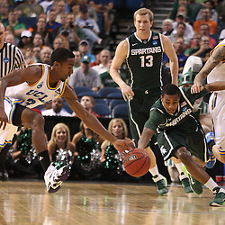 Mar 17, 2011; Tampa, FL, USA; UCLA Bruins guard Malcolm Lee (3) steals the ball from Michigan State Spartans guard Durrell Summers (15) during the first half of the second round of the 2011 NCAA men's basketball tournament at the St. Pete Times Forum.  Mandatory Credit: Derick E. Hingle