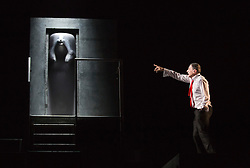 "© Licensed to London News Pictures. 14/02/2013. London, England. Hugues Quester behind door with Sergie Maggiani. The Barbican brings Eugène Ionesco's play ""Rhinocéros"" by Théâtre de la Ville from Paris to London. In this play, villagers turn into rhinoceri. It warns against totaliarism and the destructive power of the collective. From 14 to 16 February 2013. Photo credit: Bettina Strenske/LNP"