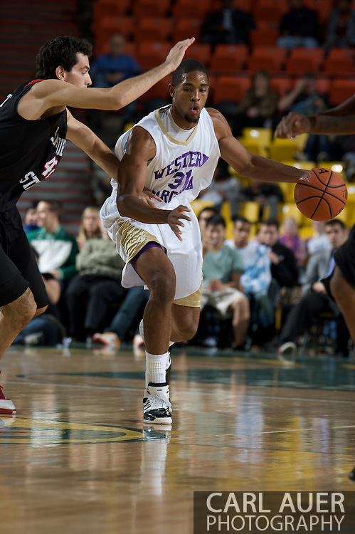 November 27, 2008: Western Carolina's Adrian Gailliard (31) tries to get past San Diego State's Mehdi Cheriet in the final game in the opening round of the 2008 Great Alaska Shootout at the Sullivan Arena