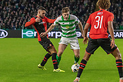 James Forrest (#49) of Celtic weaves between 2 Rennes players during the Europa League match between Celtic and Rennes at Celtic Park, Glasgow, Scotland on 28 November 2019.