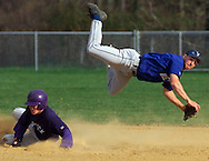 Valley Central shorstop Joe Greany is upended by Warwick's Joe Gorton after forcing Gorton out at second base on a double play attempt during the championship game of the Valley Central Viking Invitational baseball tournament yesterday in Montgomery. (Tom Bushey photo. April 25, 2000).