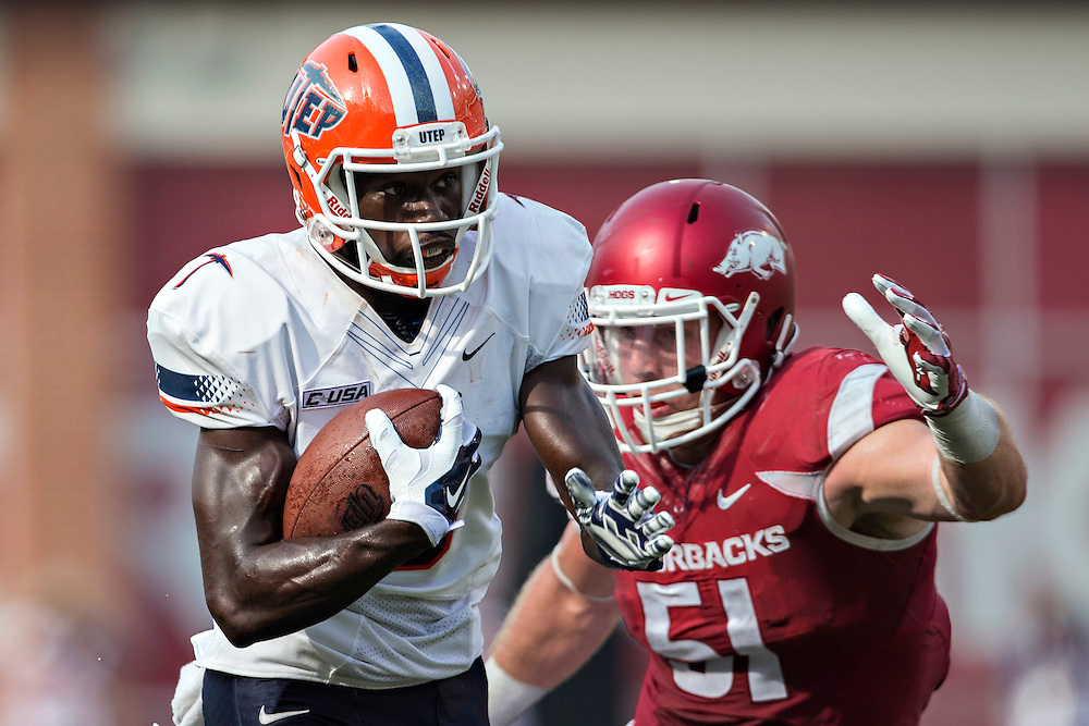 FAYETTEVILLE, AR - SEPTEMBER 5:  Jeremiah Laufasa #4 of the UTEP Miners runs the ball and is chased from behind by Brooks Ellis #51 of the Arkansas Razorbacks at Razorback Stadium on September 5, 2015 in Fayetteville, Arkansas.  The Razorbacks defeated the Miners 48-13.  (Photo by Wesley Hitt/Getty Images) *** Local Caption *** Jeremiah Laufasa; Brooks Ellis