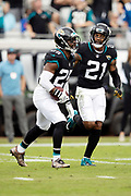 Jacksonville Jaguars defensive back D.J. Hayden (25) and Jacksonville Jaguars cornerback A.J. Bouye (21) run off the field in celebration after Hayden intercepts a first quarter pass and runs it back 10 yards to the Jaguars 28 yard line during the NFL week 13 regular season football game against the Indianapolis Colts on Sunday, Dec. 2, 2018 in Jacksonville, Fla. The Jaguars won the game in a 6-0 shutout. (©Paul Anthony Spinelli)