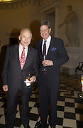 Buzz  Aldrin and Sir Toby Clarke. Launch of ' The World of Private Castles, Palaces and Estates. Syon House. 31 October 2005. ONE TIME USE ONLY - DO NOT ARCHIVE © Copyright Photograph by Dafydd Jones 66 Stockwell Park Rd. London SW9 0DA Tel 020 7733 0108 www.dafjones.com