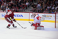 Feb. 6 2012; Glendale, AZ, USA; Phoenix Coyotes forward Boyd Gordon (15) skates in to score a short handed goal on Detroit Red Wings goalie Joey MacDonald (31) during the first period at Jobing.com Arena. Mandatory Credit: Jennifer Stewart-US PRESSWIRE.