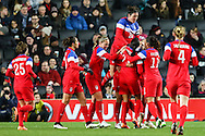 Alex Morgan of USA Women celebrates scoring the opening goal against England Women with team mates during the International Friendly match at stadium:mk, Milton Keynes<br /> Picture by David Horn/Focus Images Ltd +44 7545 970036<br /> 13/02/2015