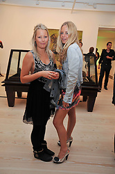 Left to right, sisters DAVINA and ASTRID HARBORD at an exhibition of photographic portraits by Bryan Adams entitled 'Hear The World' at The Saatchi Gallery, King's Road, London on 21st July 2009.
