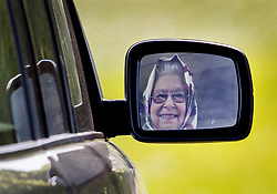 © Licensed to London News Pictures. 10/05/2017. Windsor, UK. Queen Elizabeth II is reflected in the door mirror of her Range Rover as she drives herself from the Royal Windsor Horse Show. The five day equestrian event takes place in the grounds of Windsor Castle. Photo credit: Peter Macdiarmid/LNP