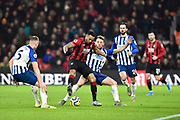 Callum Wilson (13) of AFC Bournemouth battles for possession with Dale Stephens (6) of Brighton and Hove Albion during the Premier League match between Bournemouth and Brighton and Hove Albion at the Vitality Stadium, Bournemouth, England on 21 January 2020.